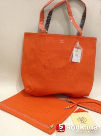 Salut , je vend un sac Hermes importé encore neuf dans sa housse , vient en  3 pièces, sac a double face (Noir   Orange) , le prix est de seulement (sa  ... c87fd4cd8cc
